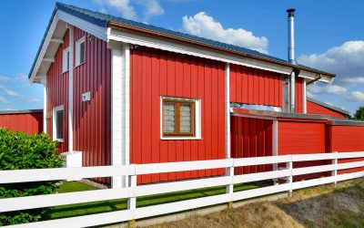 Wochenendhaus in rot zum dauerhaften Wohnen auf dem Campingplatz